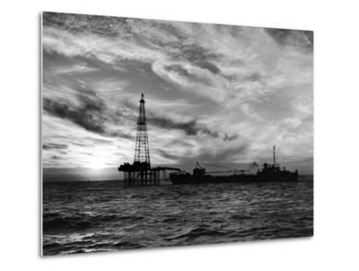 Sunset View of Humble Oil Co. Drilling Operations on Derrick Off Coast of Louisiana--Metal Print