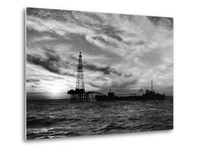 Sunset View of Humble Oil Co. Drilling Operations on Derrick Off Coast of Louisiana