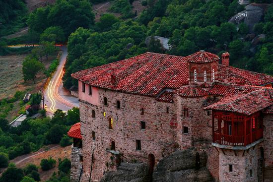 Sunsets over the Monastery of Rousanou, Built into Sandstone Pillars-Babak Tafreshi-Photographic Print