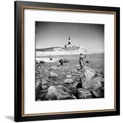 Surf Casting Fishermen Working the Shore Near the Historic Montauk Point Lighthouse-Alfred Eisenstaedt-Framed Premium Photographic Print