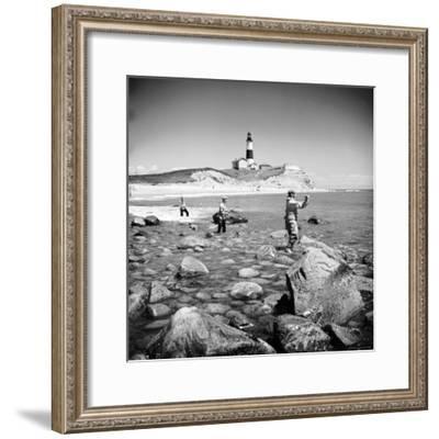 Surf Casting Fishermen Working the Shore Near the Historic Montauk Point Lighthouse-Alfred Eisenstaedt-Framed Premium Photographic Print