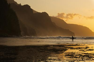 Surfer on Beach and Na Pali Coast Seen from Ke'e Beach, Ha'ena, Kauai, Hawaii-Enrique R Aguirre Aves-Photographic Print