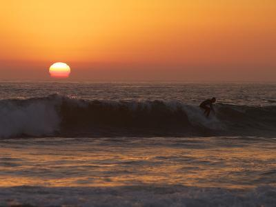Surfer Riding a Wave at Sunset over the Pacific Ocean-Tim Laman-Photographic Print