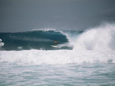 Surfer Riding a Wave in the Bonsai Pipeline in Oahu-Todd Gipstein-Photographic Print