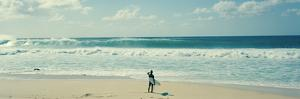 Surfer Standing on the Beach, North Shore, Oahu, Hawaii, USA