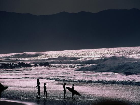 Surfers at Sunset, Ehukai, Oahu, Hawaii-Bill Romerhaus-Photographic Print