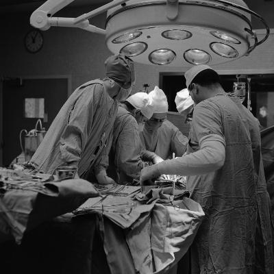 Surgical Team of Five Huddled Together, Operating on Patient-H^ Armstrong Roberts-Photographic Print