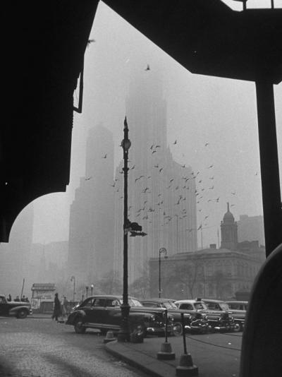 Surrounding the City in Fog, with City Hall and Woolworth Building in Background-Walter Sanders-Photographic Print