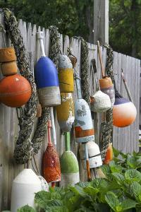 Buoys outside Lucy J's Jewelry and Glass Studio, Eastham, Cape Cod, Massachusetts, USA by Susan Pease