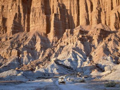 SUV Driving Through Valley of the Moon-Hubert Stadler-Photographic Print