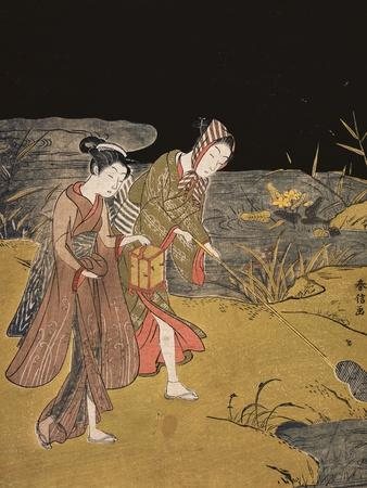A Young Couple Catching Fireflies at Night on the Banks of a River