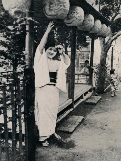 'Sweet natured smile of tea-house maid, called nesan - elder sister', c1900, (1921)-Julian Leonard Street-Photographic Print