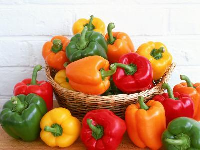 Sweet Peppers in and Around Basket-David Ball-Photographic Print