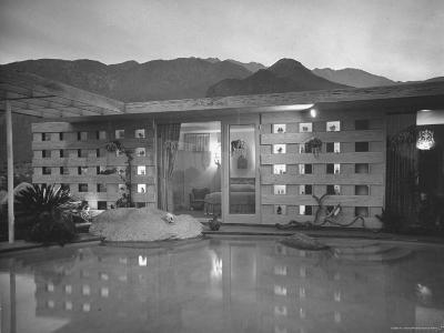 Swimming Pool at Industrial Designer Raymond Loewy's Home Running from Outdoors Into Living Room-Peter Stackpole-Photographic Print