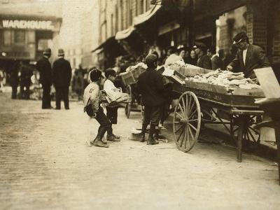 Swiping behind the Cop's Back, Boston, Massachusetts, c.1909-Lewis Wickes Hine-Photo