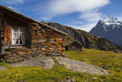 Swiss Alpine Homes Made of Stone Below Jungfrau Mountain-Jonathan Irish-Photographic Print