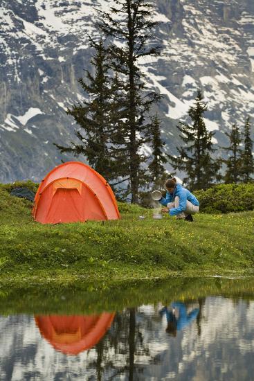 Switzerland, Canton Wallis, Bernese Oberland, Gro§e Scheidegg, Woman, Tent, Camping, Cook-Rainer Mirau-Photographic Print