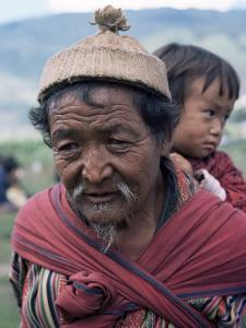 Old Man Carrying Child, Bhutan by Sybil Sassoon