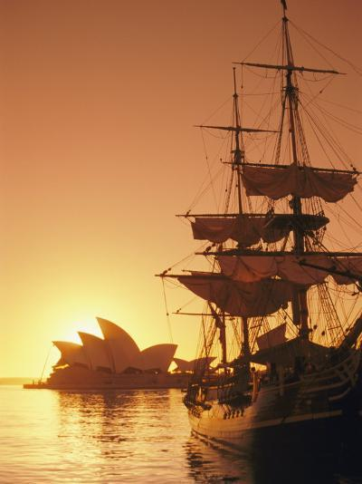 Sydney Opera House and the Hms Bounty, a Replica of the Famous Ship, Silhouetted by the Setting Sun-Richard Nowitz-Photographic Print