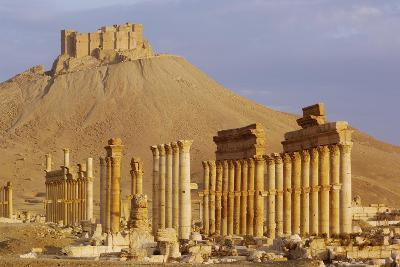 Syria, Palmyra, Column Ruins with Qalaat Ibn Maan Castle in Background--Giclee Print