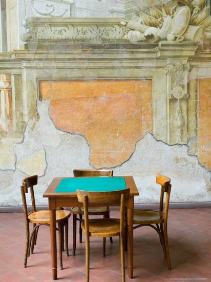 Table and Wall at 15th century Sedile Dominova Social Club, Sorrento, Campania, Italy-Walter Bibikow-Photographic Print