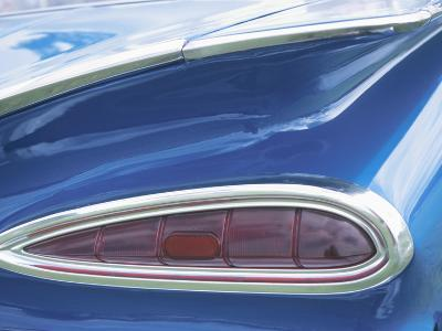 Tail Light on Blue Car--Photographic Print