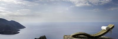 Tainaron Blue Retreat in Mani, Greece. Recliner on the Stone Patio Overlooking the Coast-George Meitner-Photographic Print
