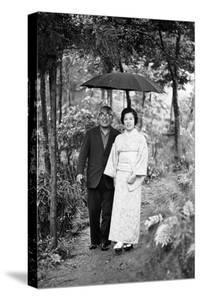Couple Pose for Portrait in the Rain, Tokyo, Japan, 1967 by Takeyoshi Tanuma