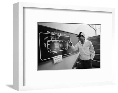 Founder of Honda, Soichura Honda Pointing to Car Race Model, Tokyo, Japan, 1967