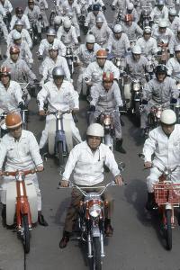 Soichiro Honda, Founder of Honda Corporation, Riding Motorcycles with Workers, Tokyo, Japan, 1967 by Takeyoshi Tanuma