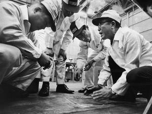 Soichiro Honda Showing Engineers Solution to Body Noise Problem at Research Facility, Japan, 1967 by Takeyoshi Tanuma