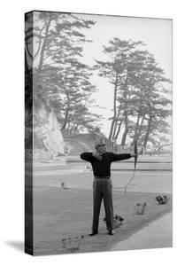 Unidentified Honda Worker in Tokyo Shooting Arrow, 1967 by Takeyoshi Tanuma