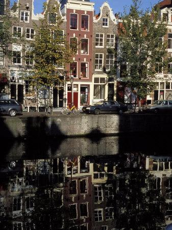 https://imgc.artprintimages.com/img/print/tall-traditional-style-houses-reflected-in-the-water-of-a-canal-amsterdam-the-netherlands_u-l-p1o6p00.jpg?p=0
