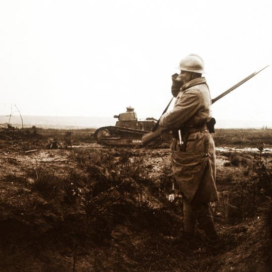 Tank and soldier on battlefield, c1914-c1918-Unknown-Photographic Print