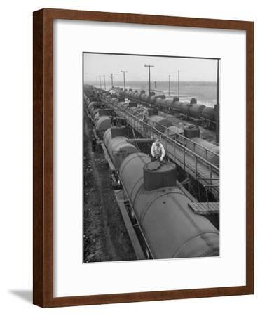 Tank Cars Line Up to Take on Crude Oil at Siding of Standard Oil of New Jersey Refinery--Framed Premium Photographic Print