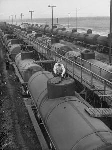 Tank Cars Line Up to Take on Crude Oil at Siding of Standard Oil of New Jersey Refinery
