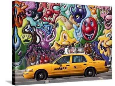 Taxi and mural painting in Soho, NYC-Michel Setboun-Stretched Canvas Print