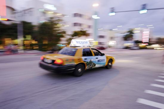 Taxi at Full Speed Early in the Evening on Collins Avenue, Miami South Beach, Florida-Axel Schmies-Photographic Print