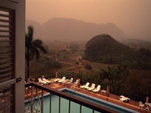 A Beautiful View from a Hotel Balcony During an Afternoon Rainshow, Vinales, Cuba by Taylor S^ Kennedy