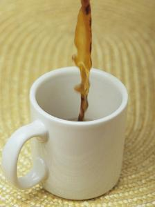 A Cup of Energy Filled Coffee is Poured into a Mug by Taylor S. Kennedy