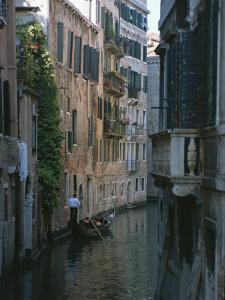 A Gondolier and Two Tourists on a Canal in Venice by Taylor S. Kennedy