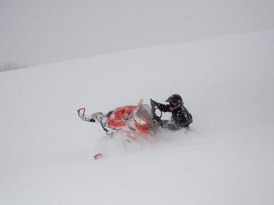 A Man Turns Sharply in Deep Powder During a Snowstorm by Taylor S. Kennedy
