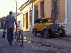A Man Walks Down the Cobblestoned Street of This Tropical Island, Trinidad, Cuba by Taylor S^ Kennedy