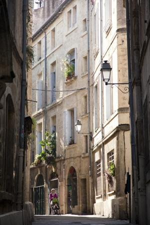 A Mother Walks Her Baby in the Back Streets of Montpellier