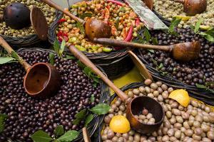A Selection of Olives Sit in a Marketplace by Taylor S. Kennedy