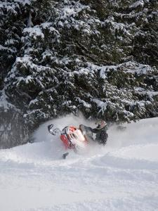 A Snowmobiler Spins Through Deep Powder by Taylor S. Kennedy