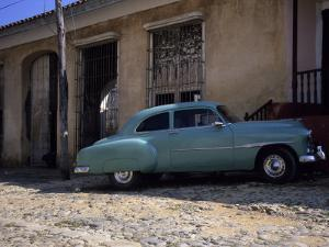 An Old American Car Sits in Front of a House, Trinidad, Cuba by Taylor S^ Kennedy