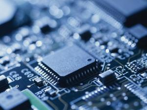 Close View of Chip on Computer Circuit Board by Taylor S. Kennedy