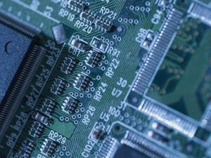 Close View of Computer Circuit Board by Taylor S. Kennedy