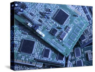 Computer Boards and Chips Lie in a Pile